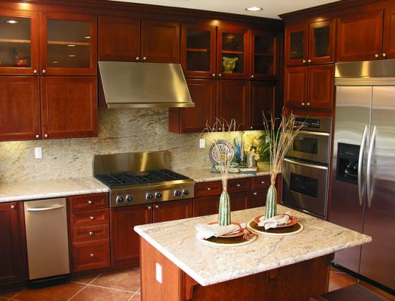 Cherry wood cabinets with granite counter tops.